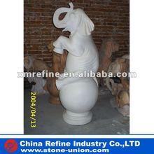 Sitting white elephant sculpture