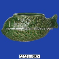 Decorative green ceramic fish planter