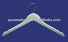 white wooden clothes hangers