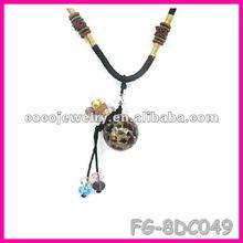 2012 yiwu fashion brown shot glass charm necklace