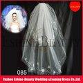 Le ruban avec du charme a affilé les robes de mariage blanches courtes à crochet pour les femmes voilées