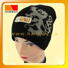 winter sports acrylic knit beanie, discharge print, fray edge patch trim with printing on it