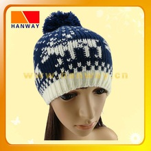 winter sports acrylic knit beanie with discharge printing and a pom-pom on the top of it