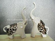 white ceramic elephant ornament