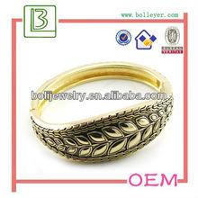 Grace leaf shaped gold metal bangle for women