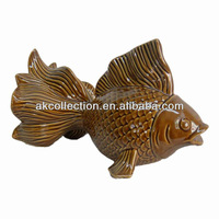 Ceramic fish sculpture with yellow finsih for home decor.