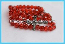 E696 Red Crackle Beaded Bracelet with Gunmetal Cross
