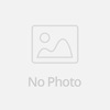 beautiful knitted Santa claus hand puppet wears a red courduroy jacket, stripey green trousers and balck velvety boots