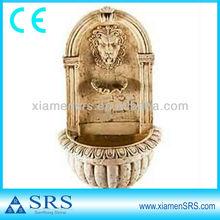 Yellow stone lion head water fountain