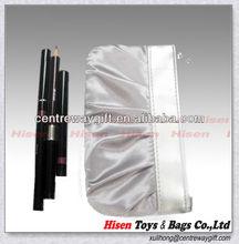 eyebrow pencil and cosmetic bag