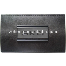 Embossed jeans leather label