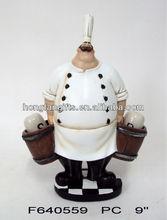 Polyresin chef holding salt and pepper shaker