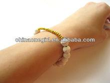 Arm candy - white turquoise gold elastic bead bracelet