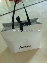 custom foil logo luxury clothing paper shopping bag with white cotton braided handle for clothing