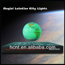 Book base floating and rotating globe with LED light