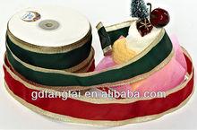 red and green christmas ribbon metal badges