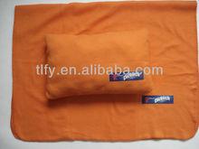 orange fleece blanket and pillow