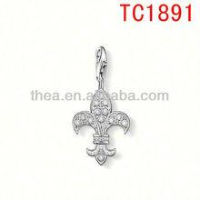 Diamond fleur-de-lis charms pendant playful ornamentation