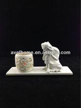Scroll tealight candle holder with sleeping buddha figurine