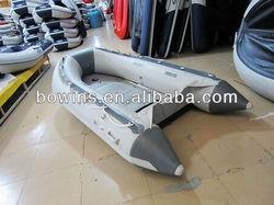 light grey aluminum inflatable boat