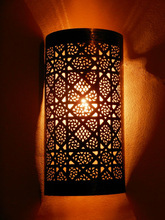 Moroccan darken metal Wall Light, Sconce and its openwork pattern.Moroccan Arts and Crafts