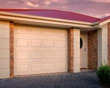 Manual lifting sectional overhead garage door