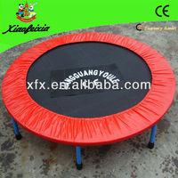children folding mini trampoline