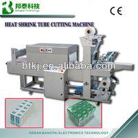 Shrink machine, shrinking packing equipment, heat shrink tube cutting machine
