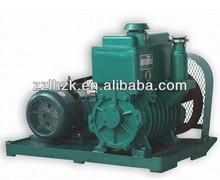 Rotary vane vacuum pump with hydraulic pressure