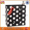 Delicate black gift shopping paper bag