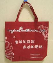 red shopping non-woven bag with white logo
