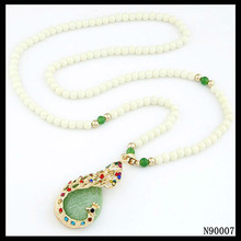 Gemstone beads chain peacock feather pendant necklace
