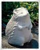 Small lively handmade stone hedgehog sculpture