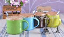 interesting ceramic coffee mug with wood lid and spoon