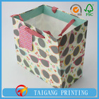 trapezoid glass design gift bag with red handle and pvc hanger 4 color printing use 150g white kraft material