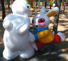 Fiberglass cartoon snowman and rabbit mascot in park