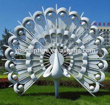 white color metal peacock sculpture