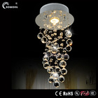Classic design spiral stair hanging light and bedroom