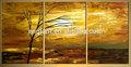 لوحات من الأشجار الحديثة الذهبي في مشهد شروق الشمس