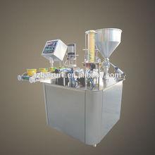 Rotary type yogurt filling and sealing machine