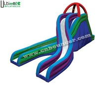 Giant crossed inflatable slide for adults