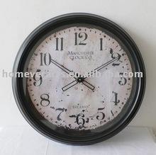 round black metal frame wall clock