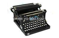 miniatura da antiga máquina de escrever