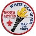antorcha logotipo de juegos scout escudo bordado