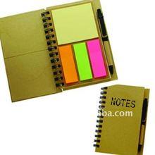 spiral notebook with sticky note