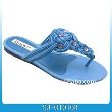 blue woven flip flops