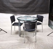 round tempered glass and metal frame ding table set
