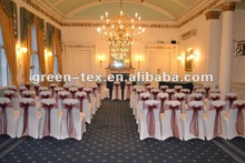White spandex chair covers with organza sashes for wedding