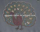 Complicated rhinestone motif, laser cut applique on garment