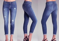 new design wholesale women denim blue skinny jeans with cutout slash detail, whiskered thighs, and washed accents